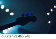 Купить «Live music background, electric bass guitar», фото № 29465940, снято 11 декабря 2016 г. (c) EugeneSergeev / Фотобанк Лори
