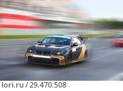 Race cars racing at high speed on a racing track. Стоковое фото, фотограф Алексей Кузнецов / Фотобанк Лори
