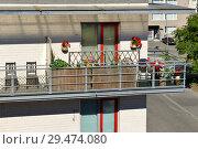 Купить «Balcony with flowers. Оулу, Финляндия», фото № 29474080, снято 11 июля 2018 г. (c) Валерия Попова / Фотобанк Лори