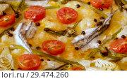 Купить «Pizza with anchovies, artichokes, cheese and sun-dried tomatoes on thin unleavoted dough», видеоролик № 29474260, снято 19 сентября 2018 г. (c) Яков Филимонов / Фотобанк Лори