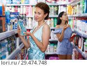 Купить «Ordinary woman looking for effective mouthwash», фото № 29474748, снято 21 июня 2018 г. (c) Яков Филимонов / Фотобанк Лори