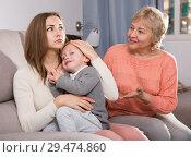 Купить «Two women are quarreling for upbringing toddler», фото № 29474860, снято 15 февраля 2018 г. (c) Яков Филимонов / Фотобанк Лори