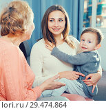 Купить «Aged woman is sharing her experience with daughter for upbringing toddler», фото № 29474864, снято 15 февраля 2018 г. (c) Яков Филимонов / Фотобанк Лори