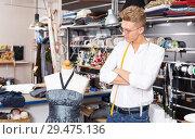 Купить «Tailor taking measurements of dummy», фото № 29475136, снято 20 октября 2018 г. (c) Яков Филимонов / Фотобанк Лори