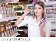 Купить «Woman smelling perfume testers in cosmetics showroom», фото № 29475252, снято 31 января 2018 г. (c) Яков Филимонов / Фотобанк Лори