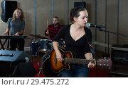 Купить «Glad guitar player and singer with band», фото № 29475272, снято 26 октября 2018 г. (c) Яков Филимонов / Фотобанк Лори