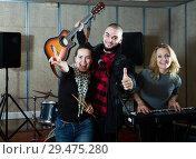 Купить «expressive group of rock musicians posing with instruments», фото № 29475280, снято 26 октября 2018 г. (c) Яков Филимонов / Фотобанк Лори