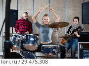 Купить «Music band with glad girl drummer rehearsing», фото № 29475308, снято 26 октября 2018 г. (c) Яков Филимонов / Фотобанк Лори