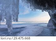 Купить «Lake Baikal in winter. View of the endless ice expanse of the lake from the grotto in the coastal cliffs», фото № 29475668, снято 28 февраля 2015 г. (c) Виктория Катьянова / Фотобанк Лори