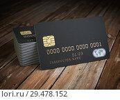 Купить «Stack of black blank credit cards mockup on wooden table background.», фото № 29478152, снято 15 декабря 2018 г. (c) Maksym Yemelyanov / Фотобанк Лори