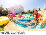 Купить «Happy teens relaxing in pool with inflatable rafts», фото № 29478216, снято 21 июля 2018 г. (c) Сергей Новиков / Фотобанк Лори