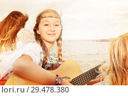 Купить «Beautiful young girl playing guitar on the beach», фото № 29478380, снято 22 июля 2018 г. (c) Сергей Новиков / Фотобанк Лори