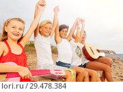 Happy friends with guitar having fun on the beach. Стоковое фото, фотограф Сергей Новиков / Фотобанк Лори