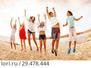 Купить «Playful teens enjoying summer on the beach», фото № 29478444, снято 22 июля 2018 г. (c) Сергей Новиков / Фотобанк Лори