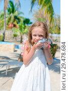 Купить «Adorable little girl with a small turtle in her hands in the natural reserve», фото № 29478684, снято 10 апреля 2017 г. (c) Дмитрий Травников / Фотобанк Лори