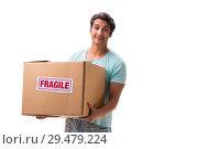 Купить «Young handsome man with fragile box ordered from Internet», фото № 29479224, снято 6 июля 2018 г. (c) Elnur / Фотобанк Лори