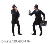 Купить «Man spy with handgun isolated on white background», фото № 29480476, снято 6 ноября 2017 г. (c) Elnur / Фотобанк Лори
