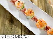 Купить «Roasted prawns on rice with saffron and lime», фото № 29480724, снято 13 декабря 2018 г. (c) Яков Филимонов / Фотобанк Лори