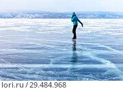 Купить «Lake Baikal. Girl skating and talking on a mobile phone. Outdoor activities in winter», фото № 29484968, снято 8 марта 2015 г. (c) Виктория Катьянова / Фотобанк Лори