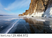 Купить «Lake Baikal. View on the icy rocks of Olkhon Island from the mirror ice at sunset. Beautiful winter landscape», фото № 29484972, снято 8 марта 2015 г. (c) Виктория Катьянова / Фотобанк Лори