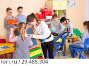 Купить «Schoolchildren during break between lessons in elementary school», фото № 29485304, снято 28 января 2018 г. (c) Яков Филимонов / Фотобанк Лори