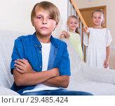 Купить «Two girls talking and sulky boy sitting separately at home», фото № 29485424, снято 19 марта 2019 г. (c) Яков Филимонов / Фотобанк Лори