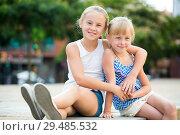 Купить «Two small happy sisters outdoors», фото № 29485532, снято 20 июля 2017 г. (c) Яков Филимонов / Фотобанк Лори