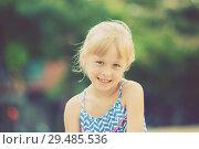 Купить «Portrait of happy girl outdoors», фото № 29485536, снято 20 июля 2017 г. (c) Яков Филимонов / Фотобанк Лори