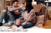 Купить «happy couple eating pop corn at home», видеоролик № 29491720, снято 20 июня 2019 г. (c) Syda Productions / Фотобанк Лори