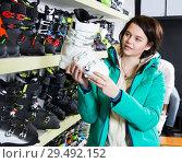 Купить «female looking for ski boots», фото № 29492152, снято 6 февраля 2018 г. (c) Яков Филимонов / Фотобанк Лори