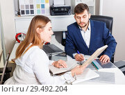 Купить «Competent seller in showroom helping young female client to choose furniture materials for her apartment», фото № 29492204, снято 9 апреля 2018 г. (c) Яков Филимонов / Фотобанк Лори