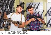 Купить «Customers 20-30 years old are choosing pneumatic rifle», фото № 29492292, снято 4 июля 2017 г. (c) Яков Филимонов / Фотобанк Лори