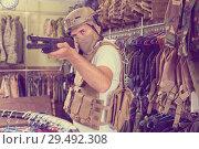 Купить «Male customer try on ammunition with rifle», фото № 29492308, снято 4 июля 2017 г. (c) Яков Филимонов / Фотобанк Лори