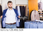 Купить «male choosing fashionl jacket», фото № 29492324, снято 28 сентября 2017 г. (c) Яков Филимонов / Фотобанк Лори