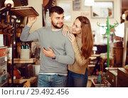 Купить «Couple looking for hallstand in shop», фото № 29492456, снято 9 ноября 2017 г. (c) Яков Филимонов / Фотобанк Лори