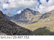 Купить «Collapsing peak under influence of weathering erosion», фото № 29497152, снято 26 июня 2018 г. (c) Виктор Никитин / Фотобанк Лори