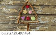 Купить «Falling snow with Christmas tree decoration», видеоролик № 29497484, снято 11 июля 2020 г. (c) Wavebreak Media / Фотобанк Лори