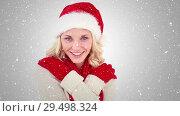 Купить «Video composition with falling snow over happy girl with santa hat smiling», видеоролик № 29498324, снято 30 ноября 2018 г. (c) Wavebreak Media / Фотобанк Лори