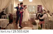 Купить «POLAND, WARSAW 9-11-2018: A costumed event. People dancing classical dances in beautiful costumes», видеоролик № 29503624, снято 22 июля 2019 г. (c) Константин Шишкин / Фотобанк Лори