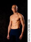 Купить «Muscular model sports young man on a dark background. Portrait of sporty healthy strong muscle guy. Sexy torso.», фото № 29508148, снято 29 октября 2018 г. (c) Иван Карпов / Фотобанк Лори