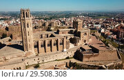 Купить «Panoramic view from drone of Catalan city of Lleida with medieval Cathedral of St. Mary of La Seu Vella», видеоролик № 29508308, снято 25 июля 2018 г. (c) Яков Филимонов / Фотобанк Лори