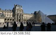 Купить «View of impressive building of Louvre Palace on sunny autumn day», видеоролик № 29508592, снято 10 октября 2018 г. (c) Яков Филимонов / Фотобанк Лори