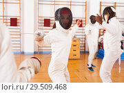 Купить «Fencers exercising techniques in battle», фото № 29509468, снято 11 июля 2018 г. (c) Яков Филимонов / Фотобанк Лори