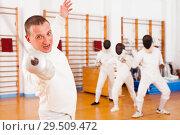 Купить «Sporty young man fencer practicing effective fencing techniques», фото № 29509472, снято 11 июля 2018 г. (c) Яков Филимонов / Фотобанк Лори