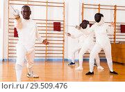 Купить «Sporty african american man fencer practicing effective fencing techniques», фото № 29509476, снято 11 июля 2018 г. (c) Яков Филимонов / Фотобанк Лори