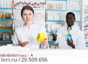 Купить «Apothecary girl recommending medicinal product», фото № 29509656, снято 2 марта 2018 г. (c) Яков Филимонов / Фотобанк Лори