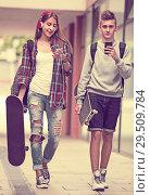 Купить «Teenagers with skateboards outdoors», фото № 29509784, снято 20 января 2019 г. (c) Яков Филимонов / Фотобанк Лори