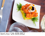 Купить «Raw salmon tartare with avocado», фото № 29509852, снято 20 марта 2019 г. (c) Яков Филимонов / Фотобанк Лори