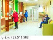 Купить «Russia, Samara, November 2018: Customer service in the Sberbank branch. Text in Russian: window», фото № 29511588, снято 3 октября 2018 г. (c) Акиньшин Владимир / Фотобанк Лори