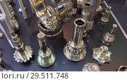 Купить «A variety of gears, splined shafts and other metal products», видеоролик № 29511748, снято 26 октября 2018 г. (c) Андрей Радченко / Фотобанк Лори
